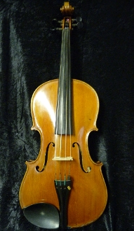 "French 16"" viola labeled René Cune. Viola was made around 1945 in Mirecourt. There is some question over the authenticity of this viola."
