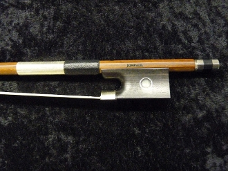 Images of a full size violin bow by JonPaul Bows. The pictures show the bow is made of ipe, a sustainable wood.