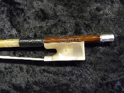"Images of a full size violin bow made in China and stamped ""Vianna"". Bow has a nice horn frog and is made pernambuco wood."