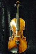 Different images of a 1940 Bohemian made small size violin. Violin is has a nice back.