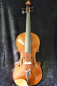 Images of a 1923 3/4 Neuner and Hornsteiner violin. Images of the front, back, scroll, and label show that the violin was kept up extremely well and is in great condition. Label shows German origin