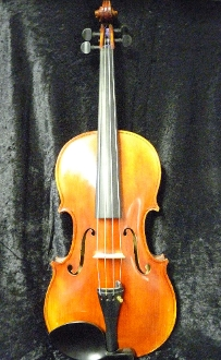 Different angles of a Karl Bauer viola, imported by William Lewis and Sons in Chicago.