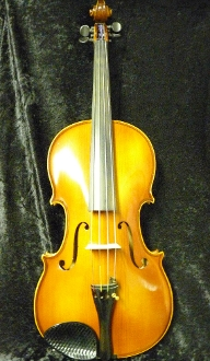 Images of an 16 inch Otto Ernst Fischer viola. The label image indicates that the viola was made in 1991 in Germany. The images show that the viola is in good condition with no major repairs.