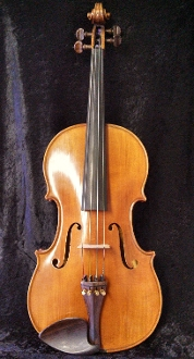 Images of a 16 and 1/2 inch viola made by Erich Werner in Germany in 1978. Viola has a stamp at the neck juncture as well as nice carving all around.